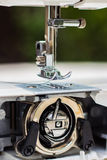 Sewing Machine close up. Close up of a sewing machine foot and the inner bobbin case Royalty Free Stock Images