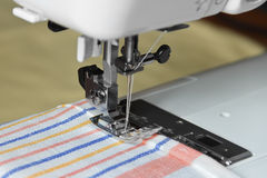 Sewing on a machine Royalty Free Stock Photos