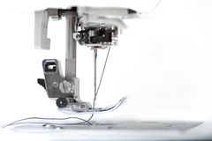 Sewing machine closeup on white background. Sewing machine part with needle closeup on white background Royalty Free Stock Image