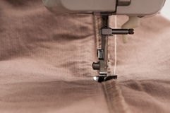 Sewing machine and cloth Stock Photos