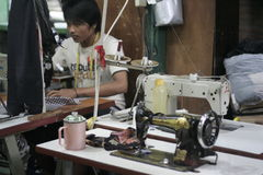 Sewing Machine And Clothes Modern Tailor Stock Photos