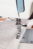Sewing machine and decorative edging cord. Royalty Free Stock Photos