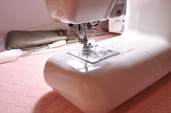 Sewing machine on desktop Royalty Free Stock Images