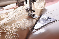 Sewing machine on desktop Stock Images