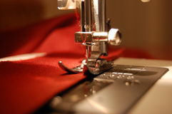Sewing Machine Detail. With the red thread and cloth Royalty Free Stock Images