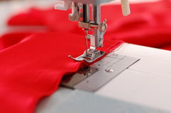Sewing Machine Detail. With the red thread and cloth Royalty Free Stock Photos