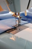Sewing Machine Detail. With the blue thread and cloth Stock Photos