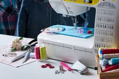 Sewing Machine With Different Accessories On White Table. Royalty Free Stock Image