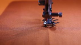 Sewing machine while embroidering stock video
