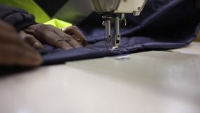 Sewing machine embroidering an item of clothing stock video