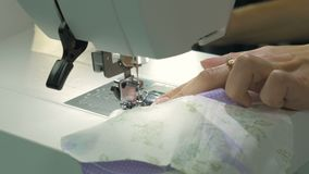 The sewing machine ends sewing two fabrics. The final stage. Close-up stock video footage