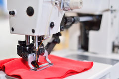 Sewing machine. Equipment garment factory. The concept of the te Stock Image