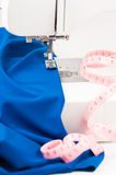 Sewing machine, fabric draped and centimeter on a white backgrou Royalty Free Stock Image