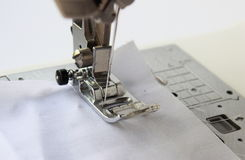 Sewing machine with fabric isolated on white background. Close up royalty free stock photography