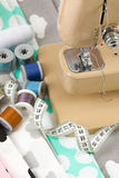 Sewing machine, fabric and measurement tape Royalty Free Stock Photos