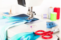 Sewing machine and fabric Stock Photos