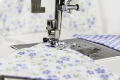 Sewing Machine And Fabric. Stitching a Bunting together with a sewing machine Stock Image