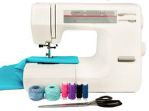 Sewing machine with fabric, threads and scissors Royalty Free Stock Images