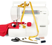 Sewing machine with fabric, threads and scissors Stock Photos