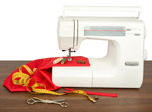 Sewing machine with fabric, threads and scissors Royalty Free Stock Photography