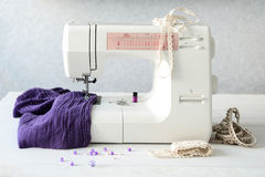 Sewing machine with fabric and threads Stock Photography