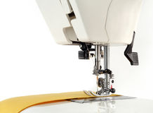 Sewing machine and fabric on a white background. Royalty Free Stock Photography