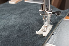 Sewing machine foot and item of clothing Stock Image