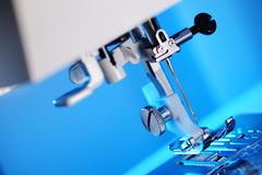 Sewing machine foot Stock Images