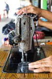 Sewing machine and hand Royalty Free Stock Image