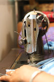 Sewing machine and hand Stock Photos