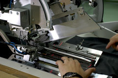 Sewing machine and hands Stock Images