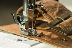 Sewing machine. And item of clothing Royalty Free Stock Photography