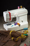Sewing machine. And item of clothing Stock Photos