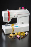 Sewing machine. And item of clothing Stock Images