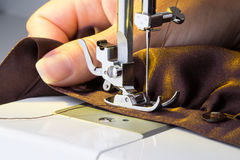 Sewing machine. And item of clothing Royalty Free Stock Images