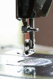 The sewing machine and item of clothing, Detail of sewing machine and sewing accessories, old sewing machine Stock Photo