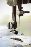 The sewing machine and item of clothing, Detail of sewing machine and sewing accessories, old sewing machine Royalty Free Stock Images