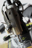 The sewing machine and item of clothing, Detail of sewing machine and sewing accessories, old sewing machine Stock Image