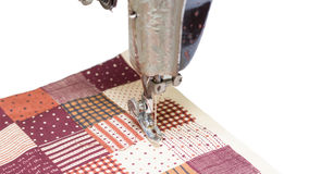 Sewing machine and item of clothing isolated Royalty Free Stock Images