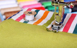Sewing machine and item of clothing material Royalty Free Stock Images