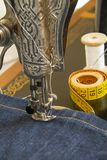 Sewing machine and item of clothing material Stock Image