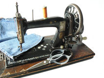 Sewing machine and jeans Royalty Free Stock Images