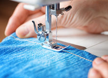 Sewing machine and jeans fabric Stock Image