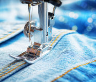 Sewing machine and jeans fabric Royalty Free Stock Image