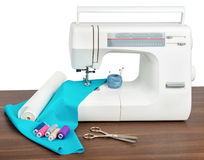 Sewing machine with many utensils on table Stock Photography