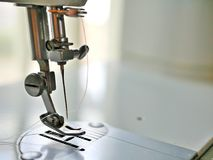Sewing machine metal needle and thread royalty free stock image