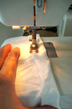 Sewing by machine Stock Images