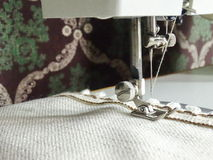 Sewing machine and a natural fabric. With lace Stock Photo