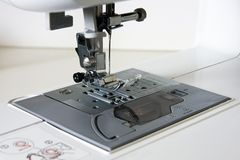 Sewing machine neddle and presser Stock Image