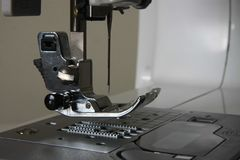 Sewing machine neddle and presser Royalty Free Stock Image